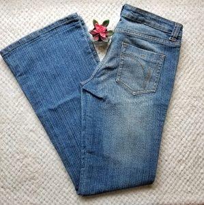 Wet Seal Long Flare Leg Faded Denim Jeans